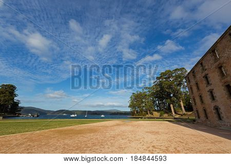 Evening view of old Penitentiary near Mason Cove at Port Arthur on Tasman Peninsula in south east of Tasmania, Australia.