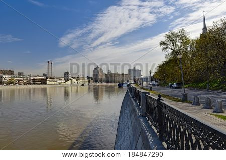 MOSCOW/ RUSSIA - MAY 1, 2017. Krasnopresnenskaya embankment and Moskva-river as seen from the embankment of Taras Shevchenko. Moscow, Russia. Moscow, Russia