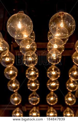 Retro style of Edison light bulbs decoration on ceiling in department store.