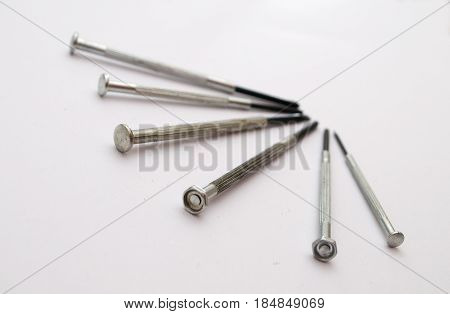 Six screwdrivers rigged in some form on a white background
