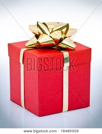 Red gift box wrapped with gold ribbon and bow.