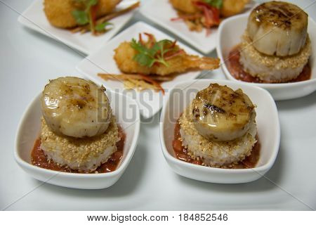 Grilled scallops with rice indian style closeup shot