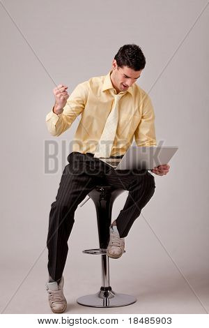 Businessman Sitting On Barstool