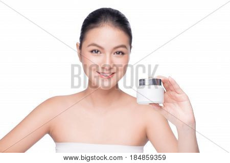 Beauty Treatment. Asian Woman Holding Moisturizing Cream Box.