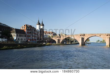Image shows an old bridge over the river Neckar in Heidelberg