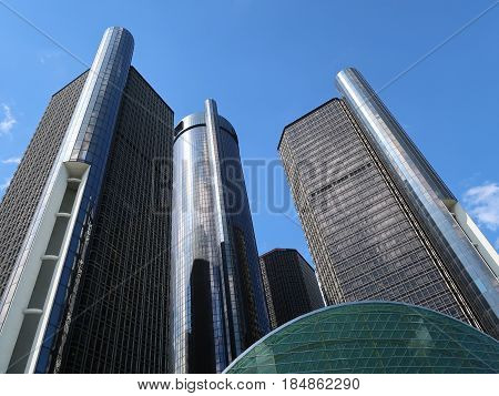 DETROIT - May 1, 2017. The sunlit towers of the Renaissance Center, located on the Detroit River in downtown Detroit, are seen rising into a blue sky. Built in 1977, the RenCen, as it is often called, is the tallest building in Michigan.