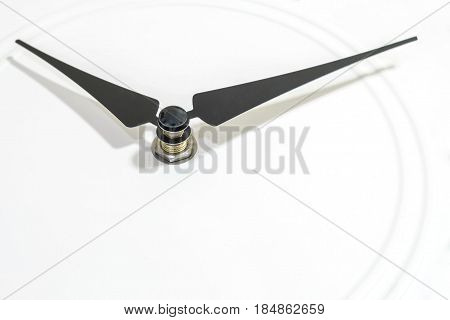 Closeup black clockwise at the white clock textured background with copy space