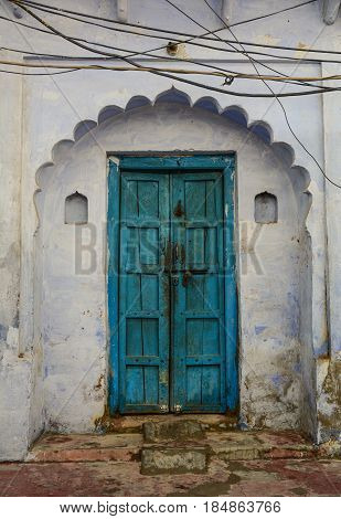 Blue Wooden Door With The Wall Of Old Building