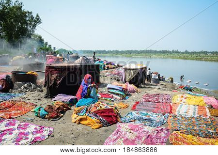 Washing Clothes On The River Bank