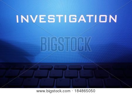 Monitor with message investigation and hands on a keyboard.
