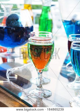 Colorful glass of cocktail on the table in bar.