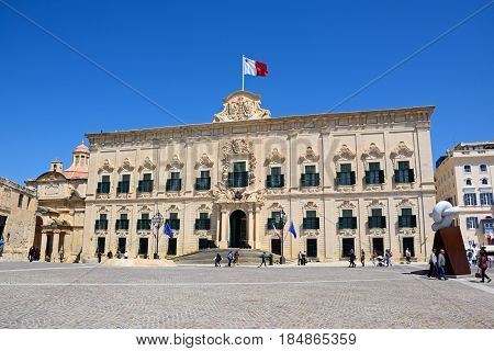 VALLETTA, MALTA - MARCH 30, 2017 - View of the Auberge de Castille (office of the Prime Minister) in Castille Square with the Bianco Carrara marble sculpture to the right hand side Valletta Malta Europe, March 30, 2017.