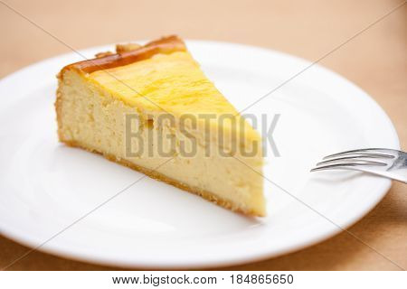 a piece of cheese cake on a white plate
