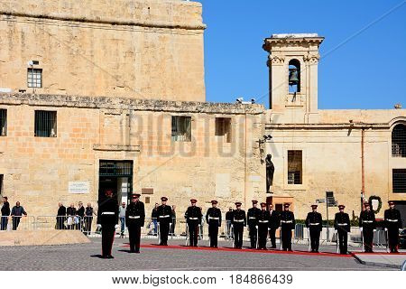VALLETTA, MALTA - MARCH 30, 2017 - Military parade awaiting the arrival of political dignitaries for the EPP European Peoples party congress outside the Auberge de Castille Valletta Malta Europe, March 30, 2017.