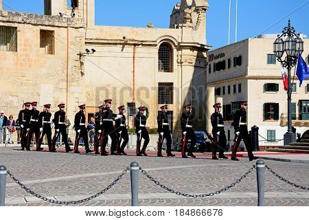 VALLETTA, MALTA - MARCH 30, 2017 - Military parade after the arrival of political dignitaries for the EPP European Peoples party congress outside the Auberge de Castille Valletta Malta Europe, March 30, 2017.