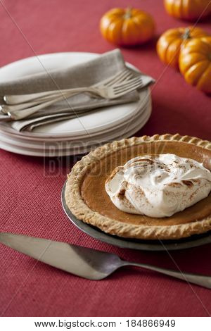 Plates, forks and pumpkin pie