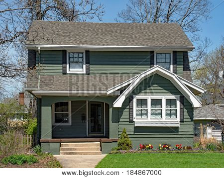 Older Two Story Home with Spring Flowers