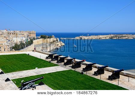 VALLETTA, MALTA - MARCH 30, 2017 - The Saluting Battery seen from the Upper Barrakka Gardens with views over the bay towards Fort Rikasoli Valletta Malta Europe, March 30, 2017.
