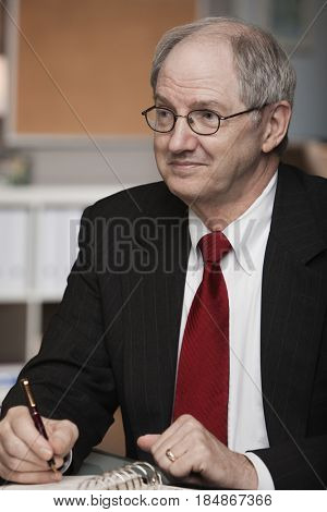 Caucasian businessman writing