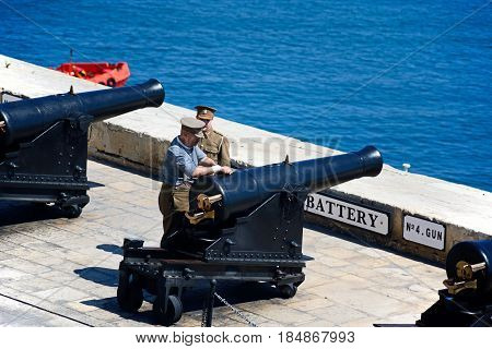 VALLETTA, MALTA - MARCH 30, 2017 - Military personnel preparing The Noon Gun in the Saluting Battery seen from the Upper Barrakka Gardens Valletta Malta Europe, March 30, 2017.