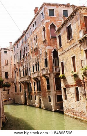 Canal in Venice, Italy. Exquisite antique buildings along Canals.