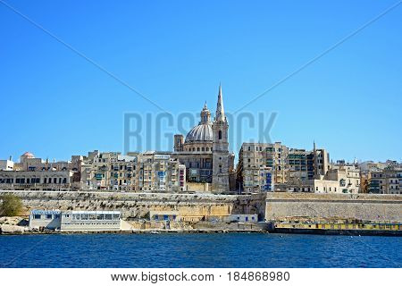 VALLETTA, MALTA - MARCH 30, 2017 - View of Valletta city buildings and waterfront seen from Marsamxett Harbour Valletta Malta Europe, March 30, 2017.