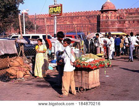 DELHI, INDIA - NOVEMBER 20, 1993 - Roadside vegetable stall and seller outside the Red Fort Delhi Delhi Union Territory India, November 20, 1993.