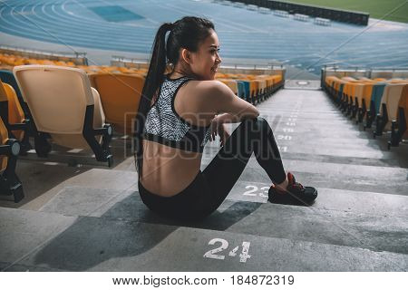 Tired Sportswoman Sitting On Stadium Stairs And Resting, Running Woman Tired Concept