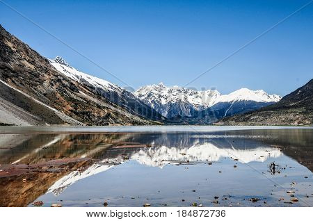 Beautiful Tibet scenery in china- ranwu lake is the largest lake in eastern Tibet, the main source of the Yarlung Zangbo River tributary. north of the famous Laguna glacier. Peak is the year-round, overlapping ups and downs of the snow-capped mountains.