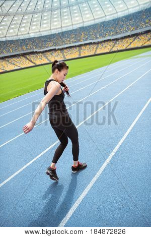Young Asian Sportswoman Sprinting On Running Track Stadium