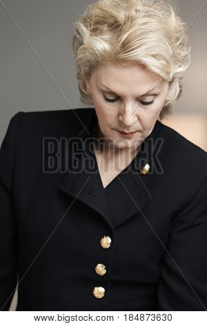 Serious Caucasian businesswoman looking down