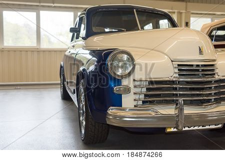 NOVI PETRIVTSI, UKRAINE - APRIL 2017: Classic car with closeup on headlights. Vintage vehicle front detail. The Museum of Old Vehicles in residence of ex-president of Ukraine Viktor Yanukovich.
