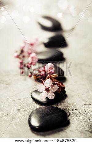 Spa setting. Massage stones on rustik background