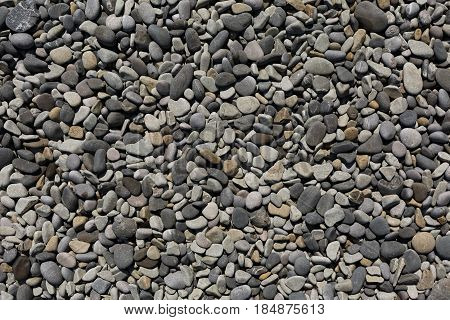 Nature background of gray sea pebbles, pebble for garden decor, pattern