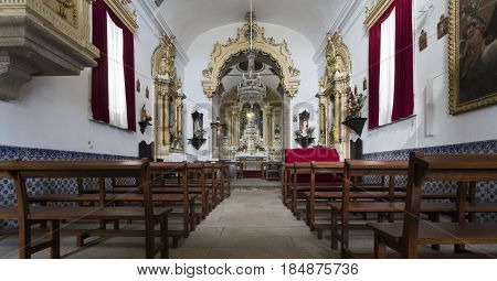 PONTE DE LIMA, PORTUGAL - OCTOBER 7, 2016: View of the church of Santo Antonio da Torre Velha interior baroque style with nave and chapel