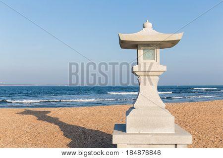 Stone lantern and seaside