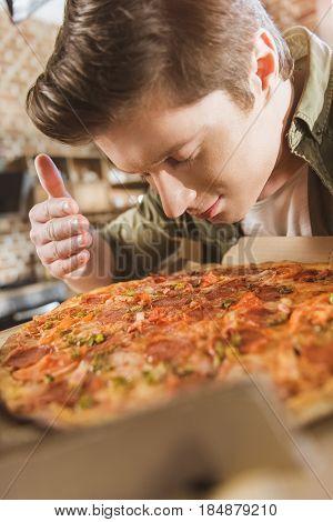 Man Enjoying Fresh Pizza