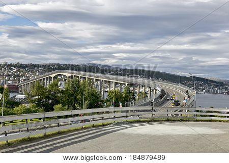 Norway, Tromso  June 25, 2015: Tromso Bridge crosses Tromsoysundet strait between Tromsdalen on mainland and island of Tromsoya. Norway