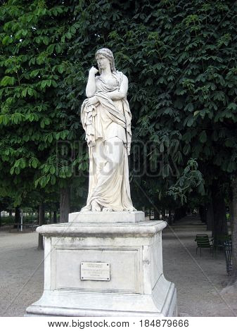 PARIS, FRANCE  JUNE 6, 2015: Luxembourg garden (Jardin du Luxembourg) in cloudy weather. garden statues, in the alleys and on the pond. FRANCE