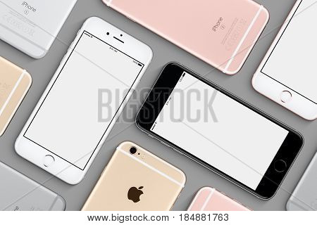 Varna Bulgaria - March 10 2016: Set of Apple iPhones 6s mockup top view flat lay with white screen and back side lies on gray surface. High quality studio shot made in Apple style.