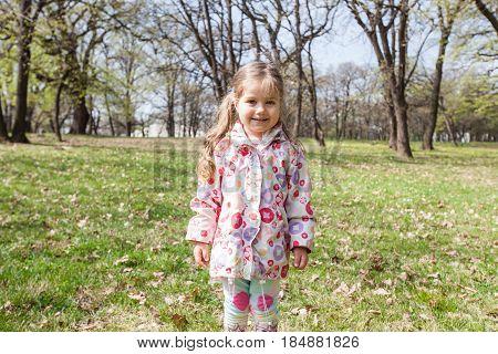 Spring Portrait Of Happy Little Girl