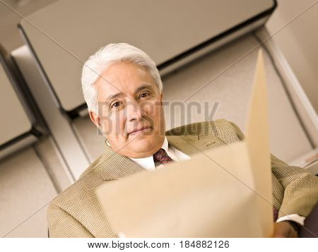Hispanic businessman holding folder