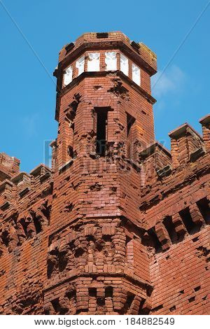 Fragment of the fortress tower against the blue sky. Architecture fortification exterior