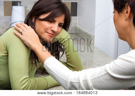 Woman providing suport for her depressed friend.
