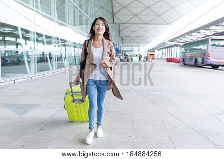 Young woman go travel with her luggage at airport