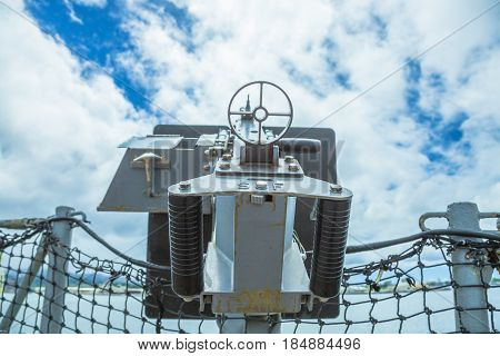 HONOLULU, OAHU, HAWAII, USA - AUGUST 21, 2016:Old machine gun of the battleship against blue cloudy sky at Pearl Harbor memorial site. Honolulu Hawaii, Oahu island of United States.