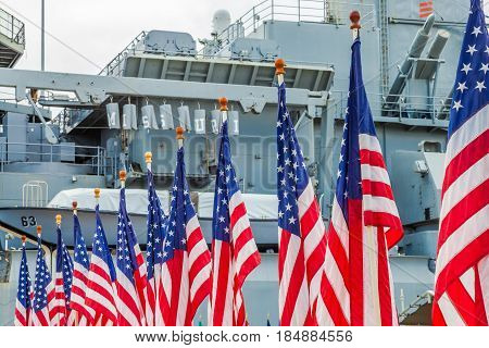HONOLULU, OAHU, HAWAII, USA - AUGUST 21, 2016:American flags with background Missouri Battleship in Pearl Harbor Honolulu Hawaii. Oahu island of United States. National historic patriotic monument.