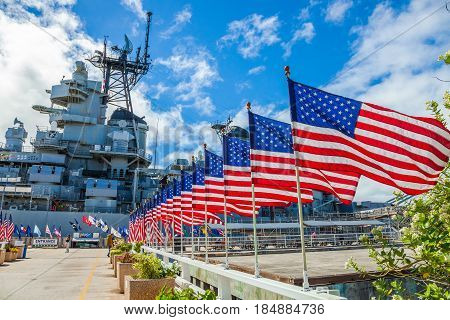 HONOLULU, OAHU, HAWAII, USA - AUGUST 21, 2016:American flags in line at Missouri Warship Memorial in Pearl Harbor Honolulu Hawaii, Oahu island of United States. National historic patriotic landmark.