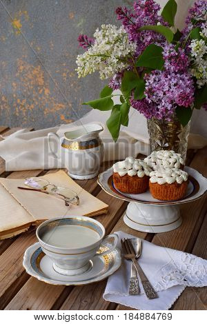 Romantic Composition Of  Bouquet White And Purple Lilacs, Cupcakes With Curd Cream, Cups Tea With Mi