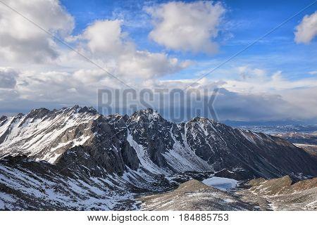 Cumulus Clouds Over A Mountain Massif